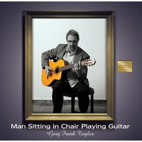 Man Sitting in Chair Playing Guitar — Gary Frank Taylor