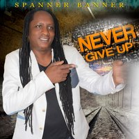 Never Give Up — Spanner Banner