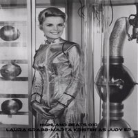 Marta Kristen as Judy — Laura Grabb