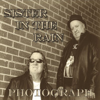 Photograph — Sister in the Rain